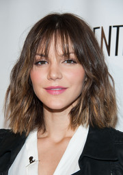 Katharine McPhee wore her hair short with edgy waves and wispy bangs when she attended the LA Confidential pre-Emmy celebration.