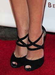 Olivia Holt donned an elegant pair of embellished black cross-trap peep-toes for the LA Confidential pre-Emmy celebration.