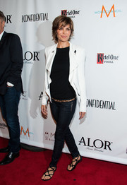 Lisa Rinna opted for a casual-edgy ensemble, consisting of skinny jeans, a black tee, and a leather jacket, when she attended the LA Confidential pre-Emmy celebration.