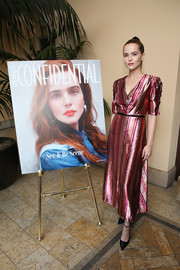 Zoey Deutch paired her frock with black ankle-strap pumps by Brian Atwood.