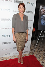Amanda Righetti pared down her gold pencil skirt with a silky sage blouse.