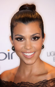 Kourtney showed off her sleek high bun while hitting the red carpet.
