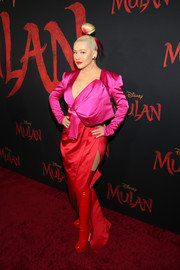 Christina Aguilera finished off her eye-catching attire with thigh-high red latex boots by Gina Shoes.