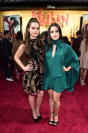 Laura Marano opted for an emerald-green keyhole-cutout dress with flowy sleeves.