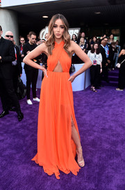 Chloe Bennet was summer-glam in an orange cutout halter gown by Blumarine at the world premiere of 'Avengers: Endgame.'