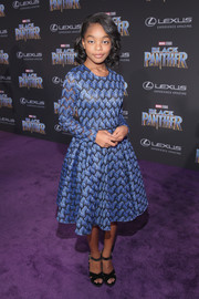 Marsai Martin paired her dress with black cross-strap platforms.