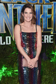 Cobie Smulders paired a nude Jimmy Choo satin clutch with a dazzling sequin dress for the world premiere of 'Black Panther.'