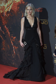 Jennifer Lawrence oozed ultra-feminine charm wearing this black Ralph Lauren gown, featuring a plunging neckline, a tiered skirt, and lace inserts, at the Madrid premiere of 'The Hunger Games: Mockingjay Part 2.'