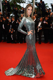 Alessandra Ambrosio stunned in a fully-sequined silver gown that featured a gold hemline and open back.