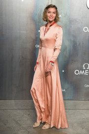 Arizona Muse was sporty-glam at the Lost in Space event in a long-sleeve peach Roksanda gown with a V neckline and red trim.