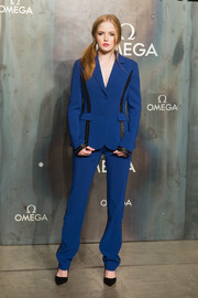 Ellie Bamber opted for an androgynous look with this studded cobalt and black pantsuit when she attended the Lost in Space event.