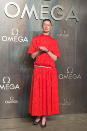 Erin O'Connor hid her slim figure beneath a loose red maxi dress when she attended the Lost in Space event.