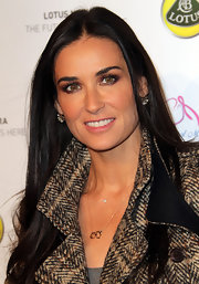 Demi Moore accentuated her hazel eyes with a deep burgundy shadow on her upper and lower lids.