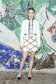 Lea Seydoux paired her jacket with a diamond-patterned mini skirt, also by Louis Vuitton.
