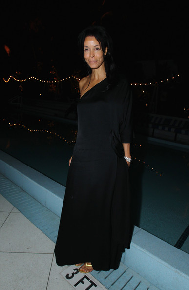 Kim Heirston looked elegant in a billowing black silk evening dress for the Louis Vuitton party in Florida.