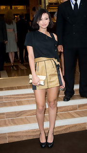 Leah Weller looked phenomenal in her gold mini skirt, she paired it with an off-the-shoulder blouse.