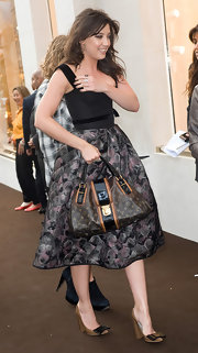 Daisy Lowe showed off her coveted runway bag while attending the Bond Street Maison Launch.
