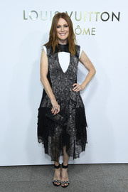 Julianne Moore channeled her inner goth princess with this jacquard and lace cocktail dress by Louis Vuitton during the brand's boutique opening in Paris.