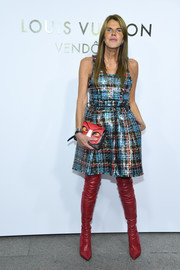 Anna dello Russo's red thigh-high boots and blue plaid dress were a fab pairing!