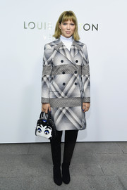 Lea Seydoux was fall-perfect in a mixed-print coat by Louis Vuitton during the brand's boutique opening in Paris.