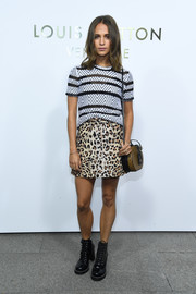 Alicia Vikander teamed her tee with a Louis Vuitton leopard-print mini skirt for a bold finish.