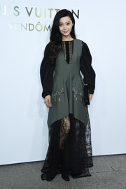 Fan Bingbing attended the Louis Vuitton boutique opening wearing a lace-hem maxi dress from the brand.