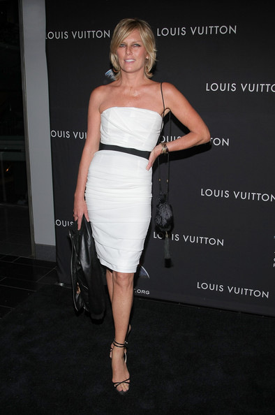 Patti wears delicate wrap around the ankle evening sandals with her strapless white dress.  What a classy choice!