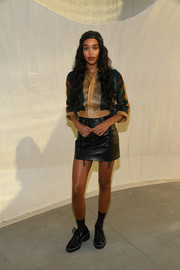 Laura Harrier matched her jacket with a black leather mini skirt.
