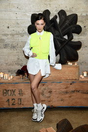 Bella Hadid was sporty in a neon-yellow vest by Louis Vuitton during the brand's dinner.