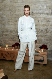 Karlie Kloss was menswear-chic in a belted white button-down with multiple pockets at the Louis Vuitton dinner.
