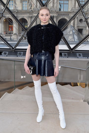 Sophie Turner teamed a black fur vest with a navy leather dress, both by Louis Vuitton, for the label's fashion show.
