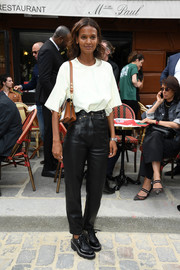 Liya Kebede sealed off her ensemble with black leather lace-ups.