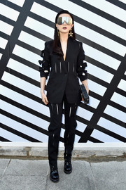 Fan Bingbing attended the Louis Vuitton fashion show rocking a slashed black pantsuit from the brand.