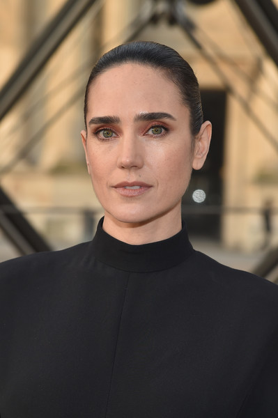 Jennifer Connelly styled her hair into a neat bun for the Louis Vuitton fashion show.