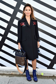 Miroslava Duma covered up in a black wool coat with an embellished yoke for the Louis Vuitton Spring 2017 show.