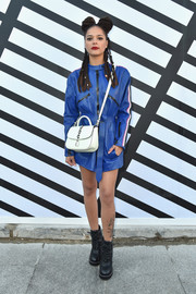 Sasha Lane looked super cool in a belted blue leather jacket by Louis Vuitton during the label's Spring 2017 show.