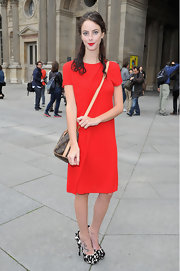 Kaya Scodelario contrasted her no-frills dress with a chic pair of black-and-white platform peep-toes when she attended the Louis Vuitton fashion show.