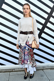 Natalia Vodianova styled her simple top with a tiered, printed mermaid skirt by Louis Vuitton.