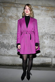 Lea Seydoux brought a dazzling pop of color to the Louis Vuitton Fall 2018 show with this belted magenta coat from the label.
