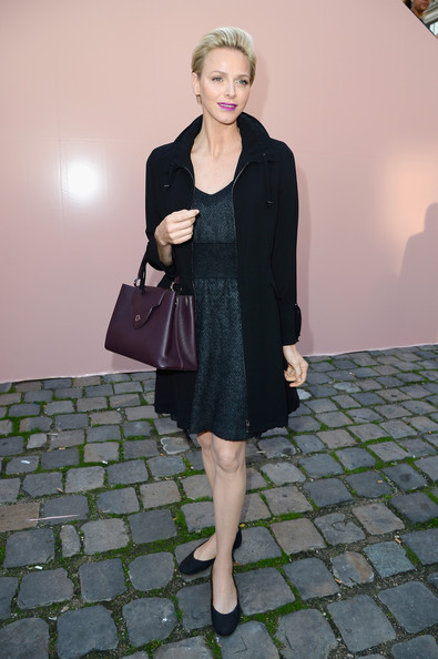Charlene Wittstock looked very classy in a black wool coat layered over a gray dress during the Louis Vuitton fashion show.