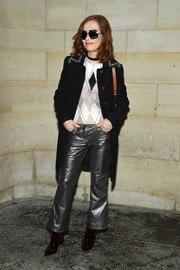 Isabelle Huppert topped off her rocker-chic look with a black tweed coat.