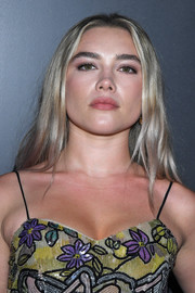 Florence Pugh looked edgy-chic with her loose center-parted 'do at the Louis Vuitton Fall 2020 show.