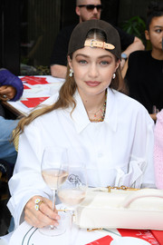 Gigi Hadid wore a cute flower ring at the Louis Vuitton Menswear Spring 2020 show.