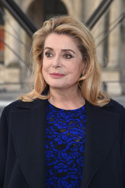 Catherine Deneuve attended the Louis Vuitton fashion show wearing a shoulder-length 'do with wavy ends.