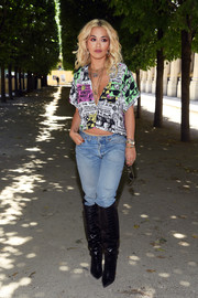 Rita Ora s stayed casual in a newspaper-print crop-top and faded jeans at the Louis Vuitton Menswear Spring 2019 show.