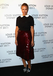 Lara Bingle added shine to her red carpet look with a sequined burgundy skirt.