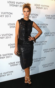 Delta Goodrem wore a black lacy cocktail dress with solid plackets for the Louis Vuitton Maison reception.