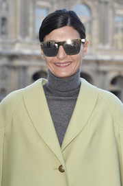 Giovanna Battaglia arrived for the Louis Vuitton fashion show wearing a pair of ultra-modern square sunnies.