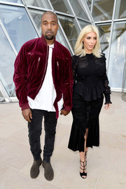 Kim Kardashian pulled her goth-glam look together with a pair of black strappy sandals, also by Givenchy.