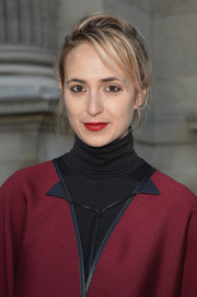 Elisabeth von Thurn und Taxis wore her hair in a messy updo at the Louis Vuitton Fall 2014 show.